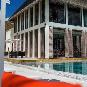 Ozen by Atmosphere at Maadhoo Island - Luxury Maldives Honeymoon Packages - Joie de vivre view of pool