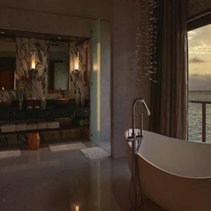 Ozen by Atmosphere at Maadhoo Island - Luxury Maldives Honeymoon Packages - OZEN Water suite bathroom