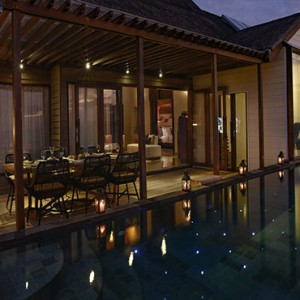Ozen by Atmosphere at Maadhoo Island - Luxury Maldives Honeymoon Packages - OZEN Water suite exterior at night