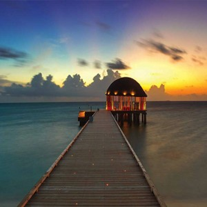 Ozen by Atmosphere at Maadhoo Island - Luxury Maldives Honeymoon Packages - Ozen arrival pavillion at sunset
