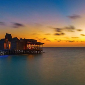 Ozen by Atmosphere at Maadhoo Island - Luxury Maldives Honeymoon Packages - Traditions restaurants sunset