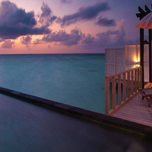 Ozen by Atmosphere at Maadhoo Island - Luxury Maldives Honeymoon Packages - Wind villa with pool exterior pool at night