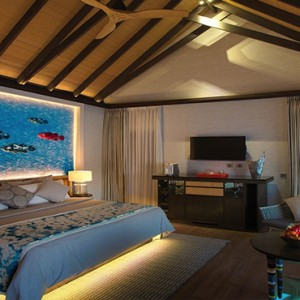 Ozen by Atmosphere at Maadhoo Island - Luxury Maldives Honeymoon Packages - Wind villa with pool interior bedroom1