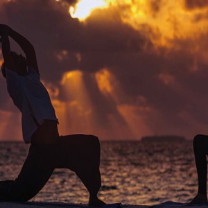 Ozen by Atmosphere at Maadhoo Island - Luxury Maldives Honeymoon Packages - Yoga session