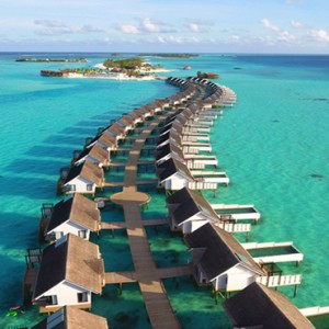 Ozen by Atmosphere at Maadhoo Island - Luxury Maldives Honeymoon Packages - aerial view of wind villas and suites