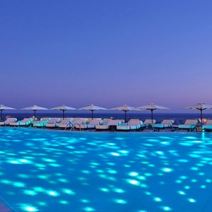 Royal Myconian Hotel and Thalassa Spa - Luxury Greece Honeymoon Packages - pool at night