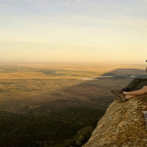 Samara Private Game Reserve - Luxury South Africa Honeymoon Packages - Couple looking out and picnic
