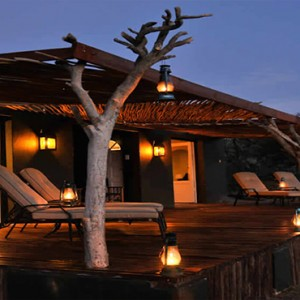 Samara Private Game Reserve - Luxury South Africa Honeymoon Packages - Sibella Suites exterior at night