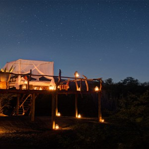 Samara Private Game Reserve - Luxury South Africa Honeymoon Packages - Star bed treehouse at night