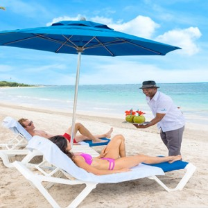 Serenity at Coconut Bay - Luxury St lucia Honeymoon Packages - Couple relaxing on beach
