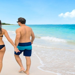 Serenity at Coconut Bay - Luxury St lucia Honeymoon Packages - Couple walking on beach