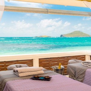 Serenity at Coconut Bay - Luxury St lucia Honeymoon Packages - Outdoor Couples spa massage with view