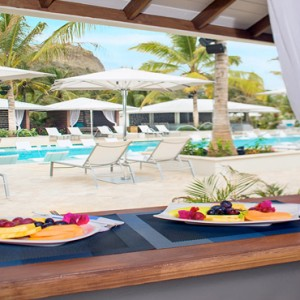 Serenity at Coconut Bay - Luxury St lucia Honeymoon Packages - dining by pool