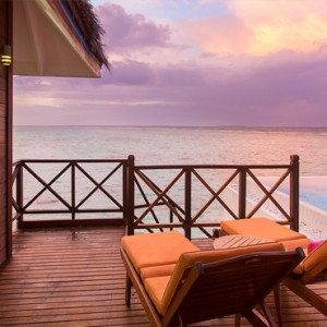Sun Aqua Vilu Reef - Luxury Maldives honeymoon packages - Aqua Suite exterior view at sunset