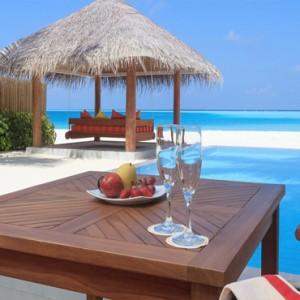Sun Aqua Vilu Reef - Luxury Maldives honeymoon packages - Deluxe Beach Villa with pool exterior dining area