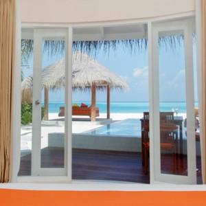 Sun Aqua Vilu Reef - Luxury Maldives honeymoon packages - Deluxe Beach Villa with pool outdoor view