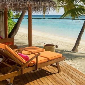 Sun Aqua Vilu Reef - Luxury Maldives honeymoon packages - Deluxe Beach villas exterior deck