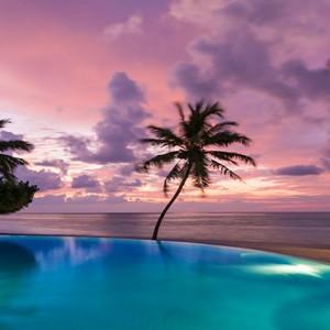 Sun Aqua Vilu Reef - Luxury Maldives honeymoon packages - Infinity pool at sunset