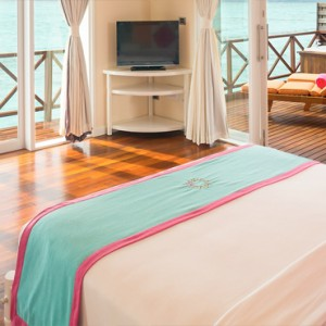 Sun Aqua Vilu Reef - Luxury Maldives honeymoon packages - Reef Villa interior bedroom