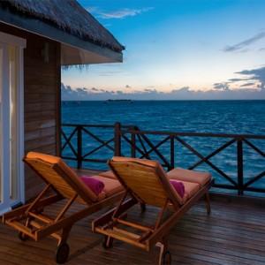 Sun Aqua Vilu Reef - Luxury Maldives honeymoon packages - Sunset Reef Villa exterior deck at night