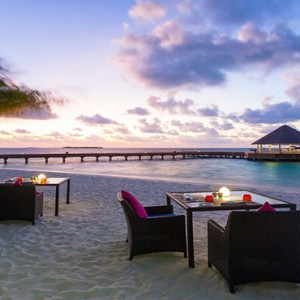 Sun Aqua Vilu Reef - Luxury Maldives honeymoon packages - Well done restaurant exterior on beach