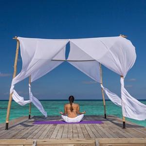 Sun Aqua Vilu Reef - Luxury Maldives honeymoon packages - Yoga