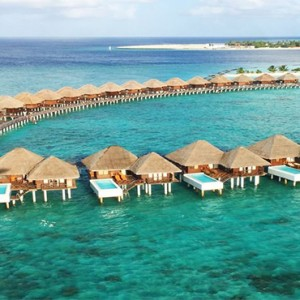 Sun Aqua Vilu Reef - Luxury Maldives honeymoon packages - aerial view of overwater villas