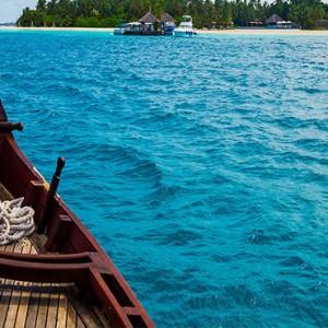 Sun Aqua Vilu Reef - Luxury Maldives honeymoon packages - excursion on dhoni boat