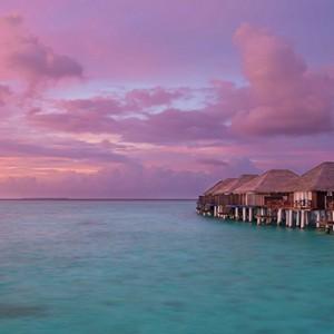 Sun Aqua Vilu Reef - Luxury Maldives honeymoon packages - overwater villas at sunset