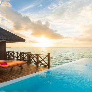 Sun Aqua Vilu Reef - Luxury Maldives honeymoon packages - pool water villas at sunset