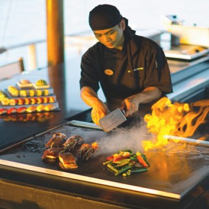 Velassaru Maldives - Luxury Maldives Honeymoon Packages - Teppanyaki chef making food