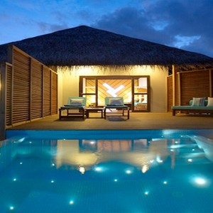 Velassaru Maldives - Luxury Maldives Honeymoon Packages - Water Bungalow with Pool exterior at night