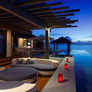Velassaru Maldives - Luxury Maldives Honeymoon Packages - Water Suite exterior at night