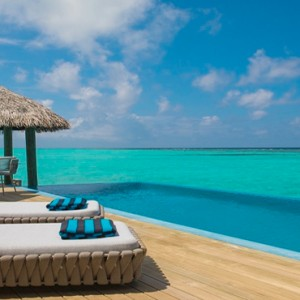 Velassaru Maldives - Luxury Maldives Honeymoon Packages - Water Suite sun loungers on deck