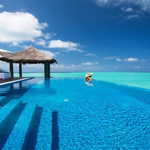 Velassaru Maldives - Luxury Maldives Honeymoon Packages - Water Suite woman in pool