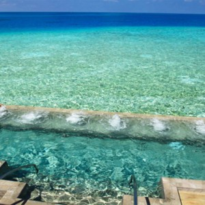 Velassaru Maldives - Luxury Maldives Honeymoon Packages - aerial view of villa pool