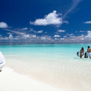Velassaru Maldives - Luxury Maldives Honeymoon Packages - couple on beach