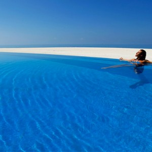 Velassaru Maldives - Luxury Maldives Honeymoon Packages - woman in pool