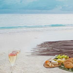 Vivanta By Taj - Coral Reef - Luxury Maldives Honeymoon Packages - Champagne breakfast on beach