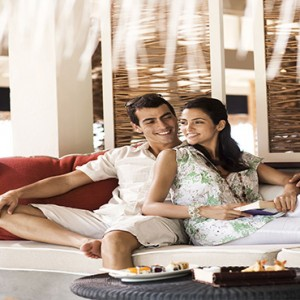 Vivanta By Taj - Coral Reef - Luxury Maldives Honeymoon Packages - Couple at the latitude