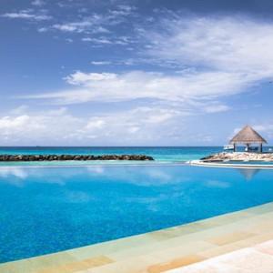 Vivanta By Taj - Coral Reef - Luxury Maldives Honeymoon Packages - Infinity pool