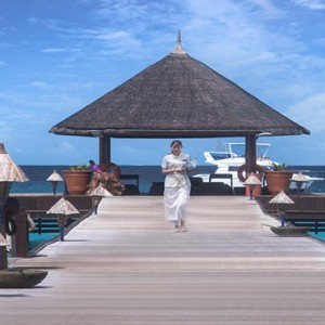Vivanta By Taj - Coral Reef - Luxury Maldives Honeymoon Packages - Jetty walkway to reception