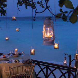 Vivanta By Taj - Coral Reef - Luxury Maldives Honeymoon Packages - Romanic escapade to a blue lagoon at night