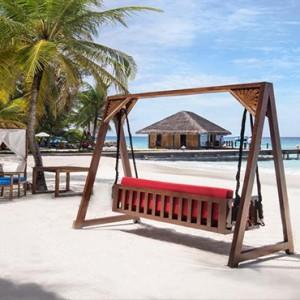 Vivanta By Taj - Coral Reef - Luxury Maldives Honeymoon Packages - hammock chair on beach