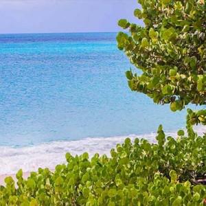 Keyonna Beach - Luxury Antigua Honeymoon Packages - Cozy dining table on restaurant deck