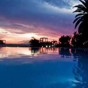 Keyonna Beach - Luxury Antigua Honeymoon Packages - The pool at night