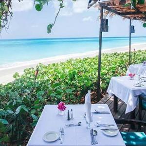 Keyonna Beach - Luxury Antigua Honeymoon Packages - dining setup at our Al fresco beachfront restaurant