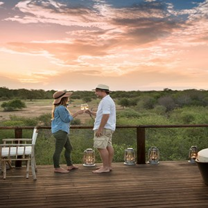 Lion Sands Game Reserve - Luxury South Africa Honeymoon Packages - Chalkley treehouse couple drinking