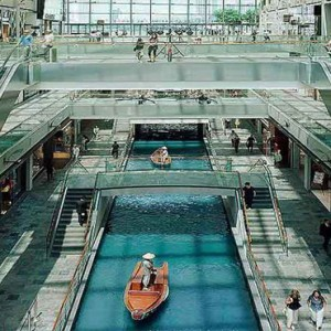 Marina Bay Sands - Luxury Singapore Honeymoon Packages - the shoppes along canal aerial view