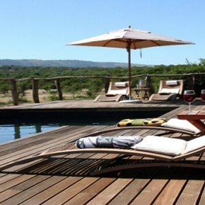 Pumba Private Game reserve - Luxury South Africa Honeymoon Packages - Bush Lodge Msenge Chalets exterior pool sun loungers and view